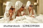 three friends in bed and luxury ... | Shutterstock . vector #1298239084