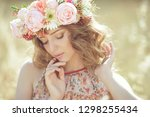 woman with a wreath | Shutterstock . vector #1298255434