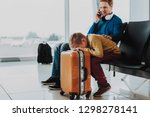boy is waiting for flight with... | Shutterstock . vector #1298278141