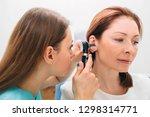 mature woman getting ear exam... | Shutterstock . vector #1298314771