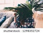 kid girl is hiding behind house ... | Shutterstock . vector #1298352724