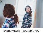 happy kid girl posing at mirror ... | Shutterstock . vector #1298352727