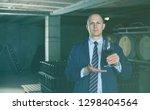 confident winemaker inviting to ... | Shutterstock . vector #1298404564