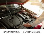 man inspection holding battery... | Shutterstock . vector #1298492101