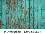 Blue Painted Plank Fence With...