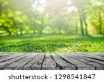 wooden table and spring grass... | Shutterstock . vector #1298541847
