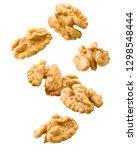 falling walnut  isolated on... | Shutterstock . vector #1298548444