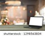 laptop blank screen on wooden... | Shutterstock . vector #1298563834
