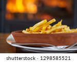 clay oval plate of french fries ... | Shutterstock . vector #1298585521