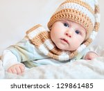 Adorable Baby Lying In Knitted...