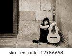 lone street artist near old... | Shutterstock . vector #12986698