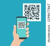 hand with phone scanning qr... | Shutterstock .eps vector #1298677867