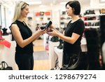 a seller propose to try boot to ... | Shutterstock . vector #1298679274