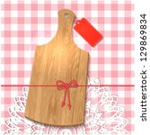 gift of cutting board on the... | Shutterstock .eps vector #129869834