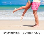 legs of young hugging couple on ... | Shutterstock . vector #1298847277