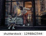 good deeds. joyful kind woman... | Shutterstock . vector #1298862544