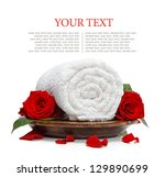 rolled white towel and roses... | Shutterstock . vector #129890699