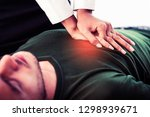 rescuer hands doing emergency... | Shutterstock . vector #1298939671