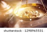 small gold nuggets in an... | Shutterstock . vector #1298965531