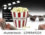 popcorn  movie clapper and film ...   Shutterstock . vector #1298969224