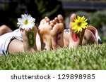 Young Girls Laying In The Gras...