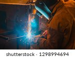 the worker in overalls and a...   Shutterstock . vector #1298994694