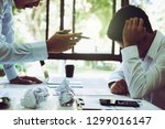 stressed asian businessman... | Shutterstock . vector #1299016147