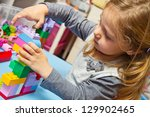 little girl is playing with... | Shutterstock . vector #129902465