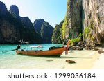 longtail boat anchored by... | Shutterstock . vector #1299036184
