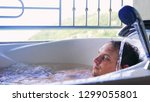 young man relaxing in the... | Shutterstock . vector #1299055801