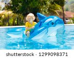 child playing in swimming pool. ... | Shutterstock . vector #1299098371