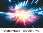 abstract motion blur in city in ... | Shutterstock . vector #1299098797