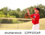 Young Baseball Player In Red...