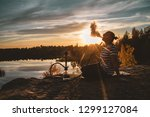 the girl smokes a hookah on the ... | Shutterstock . vector #1299127084