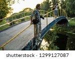 nature photographer tourist... | Shutterstock . vector #1299127087