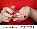 woman in red dress with pills... | Shutterstock . vector #1299137284