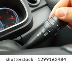 Small photo of Driver hand using car turn signal stick/blinker switch