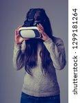 young gamer girl play mobile vr ... | Shutterstock . vector #1299181264
