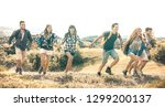 group of friends running on... | Shutterstock . vector #1299200137