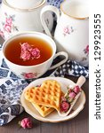 Cup of tea, fresh milk and Belgian waffles for breakfast. - stock photo