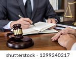 judge gavel with scales of... | Shutterstock . vector #1299240217