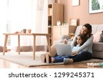 busy mother with daughter... | Shutterstock . vector #1299245371