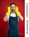 man in apron with gloves... | Shutterstock . vector #1299245911