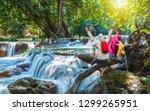 happy couple travelers joy fun... | Shutterstock . vector #1299265951