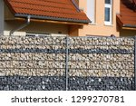 gabion fence wall | Shutterstock . vector #1299270781