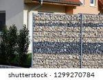 gabion fence wall | Shutterstock . vector #1299270784