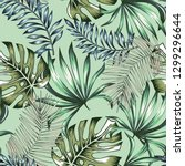 tropical palm leaves  mint... | Shutterstock .eps vector #1299296644