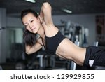 woman at the gym doing... | Shutterstock . vector #129929855