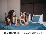 sexy girl in a short black... | Shutterstock . vector #1299304774