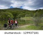 bikers near lake | Shutterstock . vector #129937181